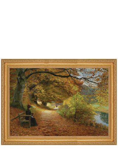 A Wooded Path In Autumn Framed Print