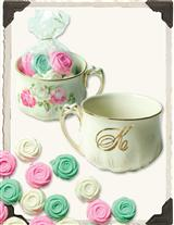 MINT ROSES IN INITIAL TEACUP