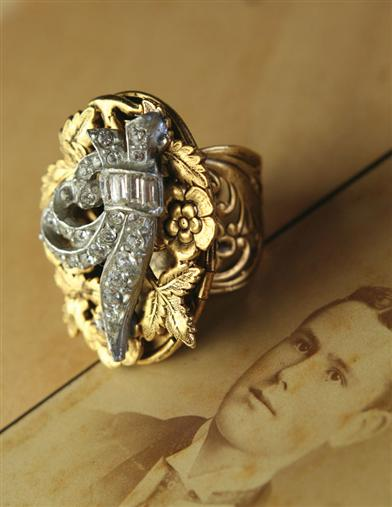 Steampunk Accessories | Gloves, Goggles, Gears, Sunglasses Flourish Locket Ring $24.99 AT vintagedancer.com