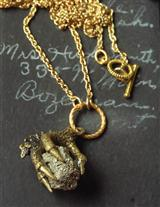 TREASURE IN TALONS PENDANT