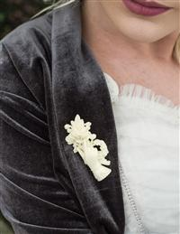Rose In Hand Ivory Brooch