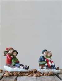 Jovial Sledding Children Figurines (Set Of 2)